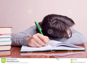 http://www.dreamstime.com/stock-photography-girl-sleeping-notebook-image23076252