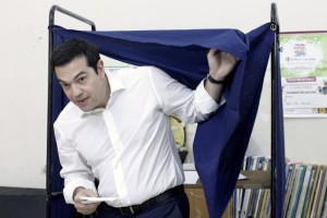 Greek Prime Minister Alexis Tsipras exits a voting booth at a polling station in Athens