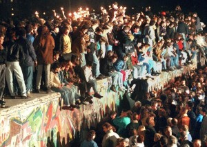 epa04469615 (FILE) A file photo dated 11 November 1989 shows people celebrating the opening of the border between East and West Germany on the Berlin Wall in Berlin, Germany. After the border was opened, millions of East Germans streamed across the border into West Berlin. The 25th anniversary of the fall of the Berlin Wall will be celebrated in Berlin on 09 November 2014.  EPA/STR