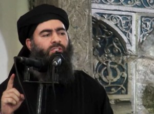 FILE - This file image made from video posted on a militant website Saturday, July 5, 2014, which has been authenticated based on its contents and other AP reporting, purports to show the leader of the Islamic State group, Abu Bakr al-Baghdadi, delivering a sermon at a mosque in Iraq. On Sunday, Nov. 9, 2014, Iraqi officials and state television said al-Baghdadi has been wounded in an airstrike in western Iraq. An Interior Ministry intelligence official told The Associated Press on Sunday that the strike happened early Saturday in the town of Qaim in Iraq's Anbar province. (AP Photo/Militant video, File)