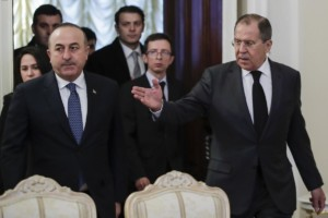 "Russian Foreign Minister Sergey Lavrov, right, welcomes Turkey's Foreign Minister Mevlut Cavusoglu, left, for the talks in Moscow, Russia, Tuesday, Dec. 20, 2016. Foreign ministers of Russia, Turkey and Iran are meeting on Tuesday to discuss Syria, but the talks are likely to be overshadowed by the assassination of Russia's ambassador to Turkey the previous night by an Ankara policeman, who after killing his victim cried out: ""Don't forget Aleppo! Don't forget Syria!"" (AP Photo/Pavel Golovkin)"
